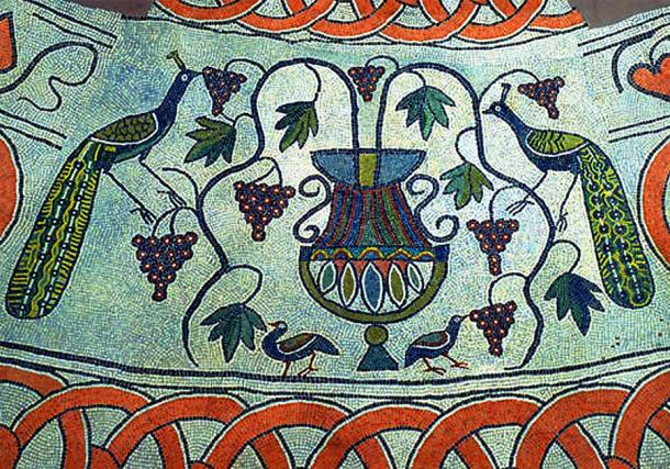 Detail of the baptistry's mosaic floor, depicting two peacocks eating grapes (Public Domain)
