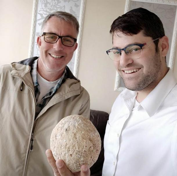 The citizen (right side) who returned the 2000-year-old ballista stone to the Israel Antiquities Authority, that he took without permission 15 years ago from the City of David.    Source: Israel Antiquities Authority