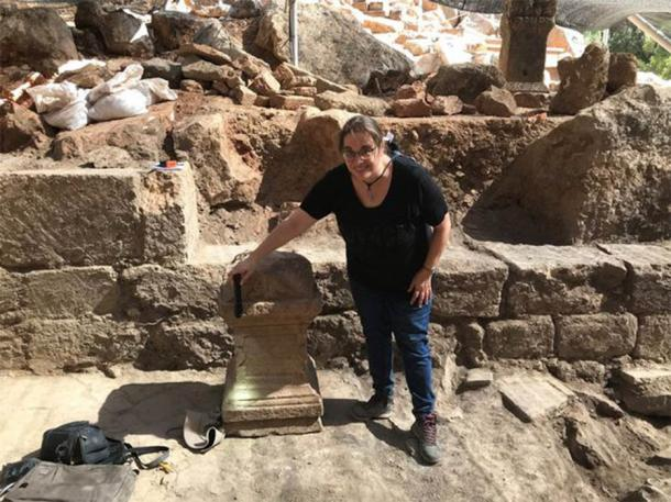 University of Haifa Prof. Adi Erlich led the dig and can be seen here with a Roman altar dedicated to Pan. This artifact suggests that the site was used for religious purposes before the Christians arrived. (Banias Excavations Team)
