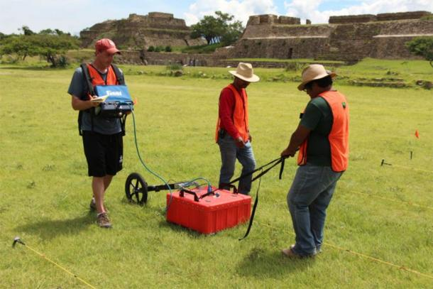 Using ground penetrating radar at Monte Albán. (Dr. Marc Levine)