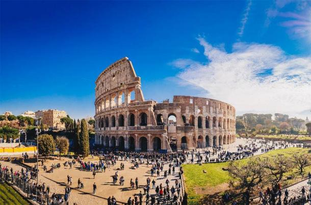 Tourists at the Colosseum. (Calin Stan /Adobe Stock)