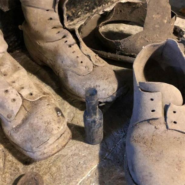 The shoes and witch bottle that traps witches and demons found under the staircase in the Welsh home. (Kerrie Jackson / Denbighshire County Council)