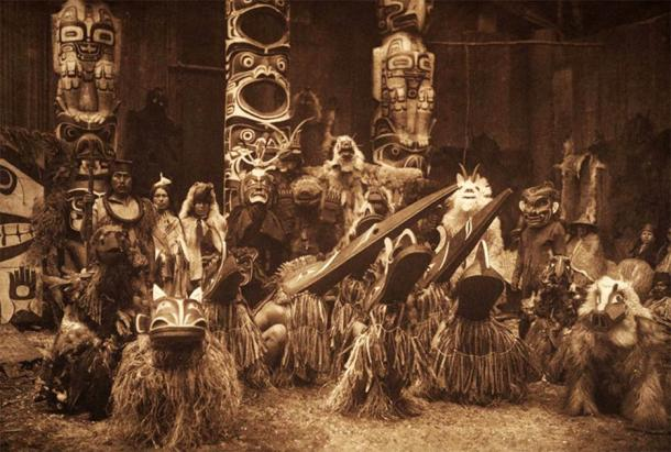 Masked Kwakiutl dancers during the winter ceremony in an iconic photo by the ethnographic photographer Edward Curtis. (Public domain)