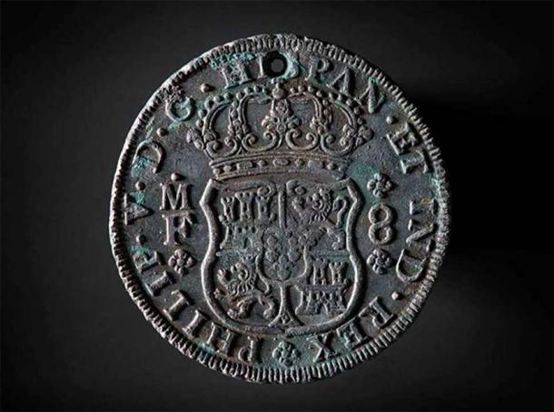 Pillar dollar, 8 reals and minted in Mexico. At the top there is a small hole, probably used to sew the coin into clothing. (Image: © Historic England/RCE)