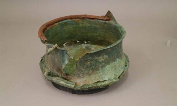 A copper vessel, one of the grave goods found in the Anglo-Saxon warrior grave. (University of Reading)