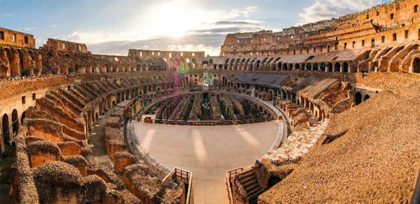 Panoramic view of Roman colosseum interior at sunset. (Martin M303 /Adobe Stock)