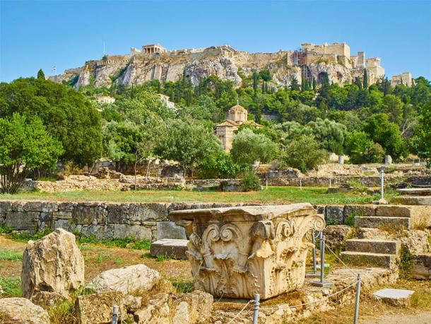Ruins of Odeon of Agrippa, Ancient Agora of Athens with Church of the Holy Apostles and the north slope of the Athenian Acropolis in background. (Álvaro Germán Vilela / Adobe Stock)