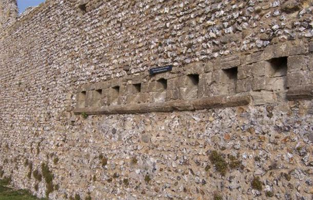 The rear view of the medieval garderobe toilets at Portchester Castle, UK, where the poop exited the castle and made a considerable stink. (Colin Babb / Medieval Garderobe (toilets) Portchester Castle)