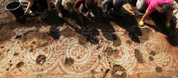 A group effort in the process of restoring the Chedworth Roman villa floor mosaic. (National Trust)