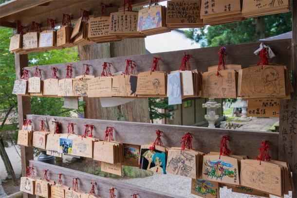Traditional wooden prayer tablets (ema) at Shirakawa Hachiman shrine in Shirakawago, Gifu, Japan, a famous historic site. (beibaoke / Adobe Stock)