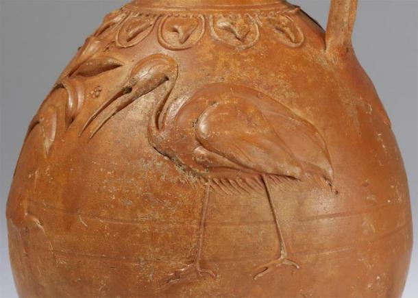 The form and the single handle suggest that this jug was used for pouring wine. It is decorated with two stork-like birds facing a large plant in the middle, framed by a garland of ivy leaves around the neck of the jug. Such idyllic scenes with animals and plants are typical of ceramic and metal vessels made during the time of Emperor Augustus. (Public Domain)
