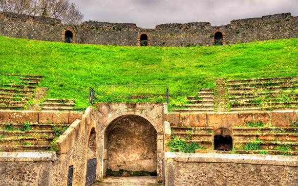 The tunnels and tiered seating of Pompeii's Amphitheater (Leonid Andronov / Adobe Stock)
