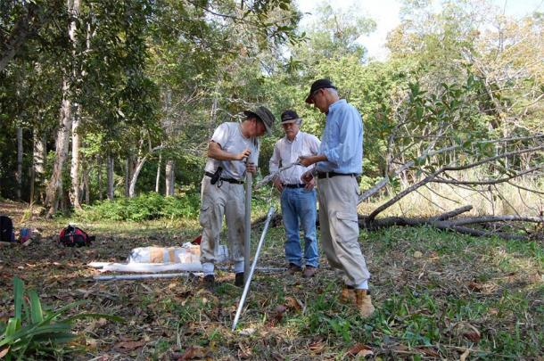 UC researchers Nicholas Dunning, left, Vernon Scarborough and David Lentz set up equipment to take sediment samples during their field research at Tikal. (Liwy Grazioso Sierra)