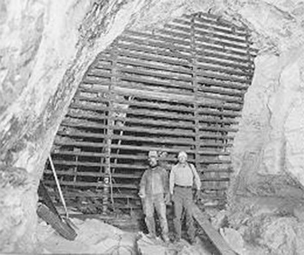 Dave Derosiers and Stan Sloan of the National Park Service show off the completed Stanton's Cave gate: 20 feet high and 20 feet across. (Bat Conservation International)