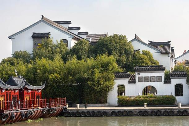 Painted barge docked at the Zhouzhuang Wansan Pier which relates to the town's long and prosperous trade history. (Weiming / Adobe Stock)