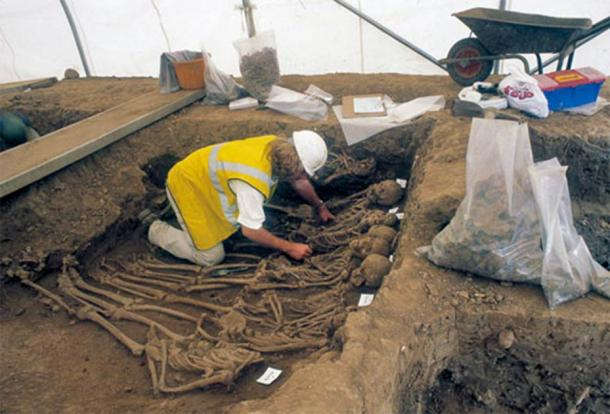 Excavating the mass burials at St Mary Spital. (MOLA)