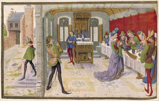People at a medieval banquet. (Archivist /Adobe Stock)