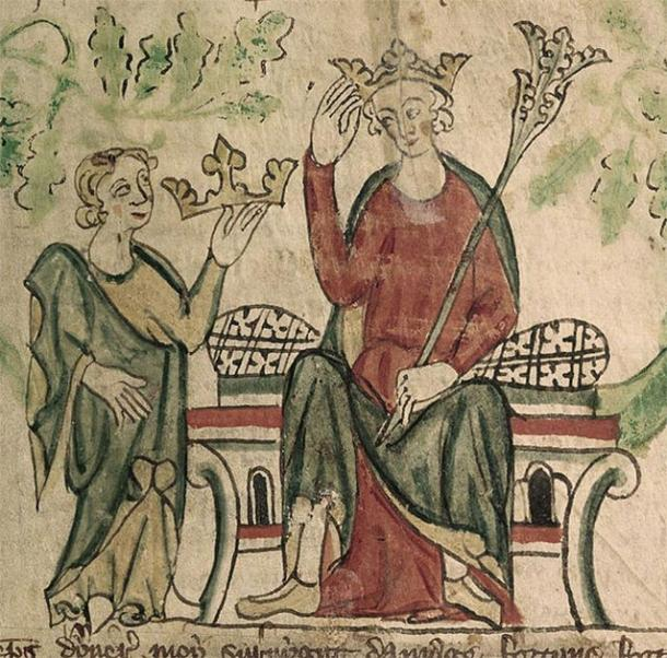 An illuminated detail from between circa 1307 and circa 1327 of Edward II of England receiving his crown. (Public Domain)