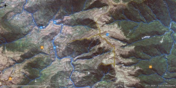 A GIS screenshot showing a fragment of the map with discovered Inca trails (continuous orange lines) and reconstructed paths (dashed lines), overlaid on a high-resolution satellite image. (Paititi Research Team)