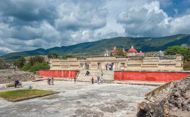 A section of the ruins in Mitla today with the church clearly visible on the northern edge of the city just beyond the primary entrance way. (javarman / Adobe Stock)