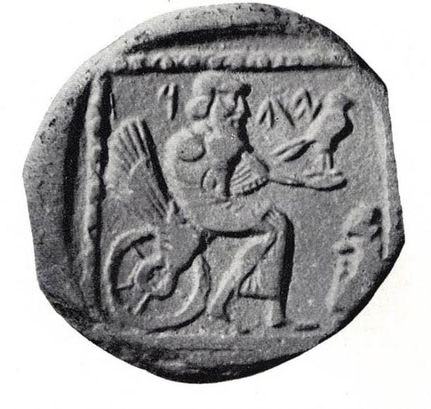 """Phoenician drachm, 4th century BC, on exhibit in the British Museum. The coin shows a seated deity, labelled either """"YHW"""" (Yahu) or """"YHD"""" (Judea). (Public Domain)"""