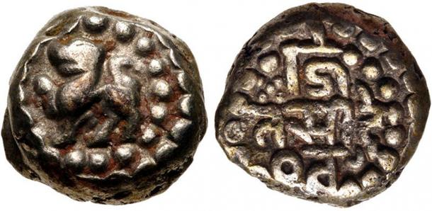 Pallava coin during the reign of Narasimhavarman I. Left side: A Lion. Ride side: The name of Narasimhavarman I surrounded by solar and lunar symbols. (Classical Numismatic Group, Inc. / CC BY-SA 3.0)
