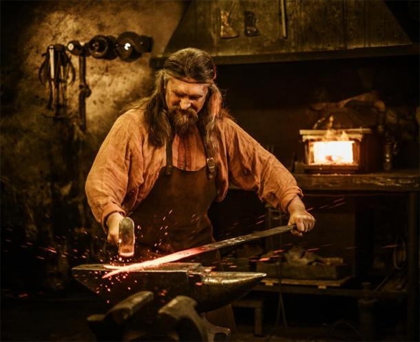 Representation of medieval blacksmith forging a sword. (Nejron Photo / Adobe stock)