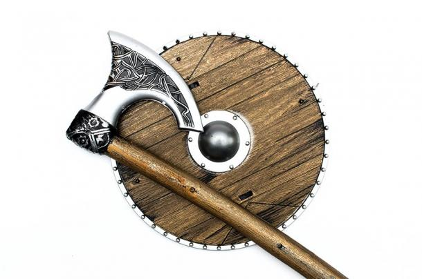 The most iconic of Viking weapons was the battle axe. Pictured: representation of Viking style axe and round shield. (Dmitriy / Adobe stock)