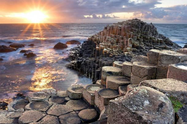 Sunset at Giant's Causeway, Northern Ireland. (aitormmfoto /Adobe Stock)