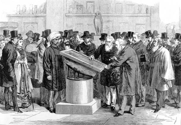Experts inspecting the Rosetta Stone during the International Congress of Orientalists of 1874. (Public Domain)