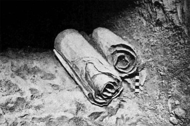 Two scrolls from the Dead Sea Scrolls lie at their location in the Qumran Caves before being removed for scholarly examination by archaeologists. ( Public Domain )