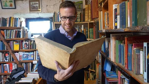 The author reading through some faerie tales in an old bookstore found at Hill of Tara. (Provided by the author)
