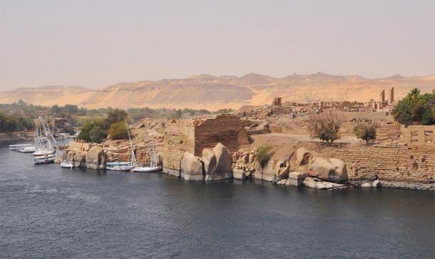 Elephantine Island in the south of Egypt, home of the Nile Flood, the god Khnum, the primeval mound of creation and the magical red Aswan granite, seen in photo as rounded mounds. Djoser and Khufu both used this sacred granite for their burials. (Marc Ryckaert / CC BY 3.0)