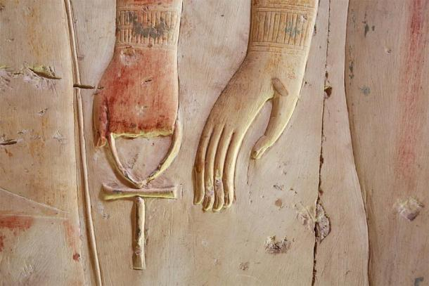 Ankh in the hand of the god on the temple wall Luxor, Egypt (Vladimir Melnik / Adobe Stock)