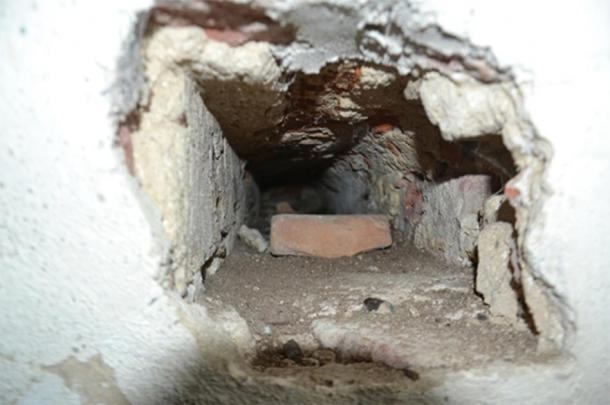 Notice the small hole in the wall against the toilet shaft. What was the purpose of a straight horizontal tunnel into the toilet shaft? (Author provided)