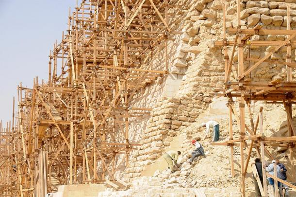Modern wooden scaffolding set up around Djoser's Step Pyramid at Saqqara (David Broad / CC BY 3.0)