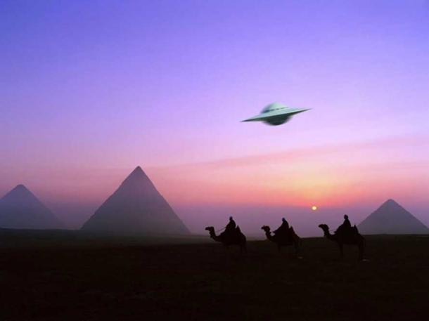 An imaginative depiction of a UFO over camels and pyramids.
