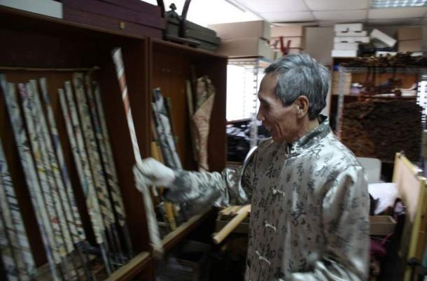 Chen laughs as he puts back one of his incomplete swords into the rack, on the left. Wrapped in newspaper in his attic, each is worth thousands.
