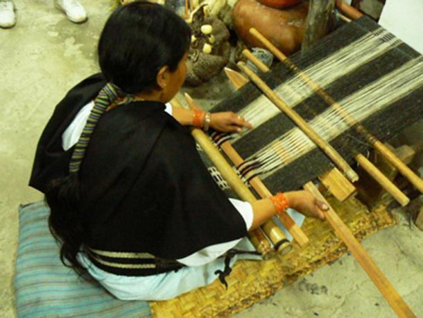 An indigenous woman using a traditional loom. (Author provided)