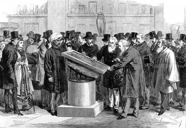 Experts inspecting the Rosetta Stone during the International Congress of Orientalists of 1874.