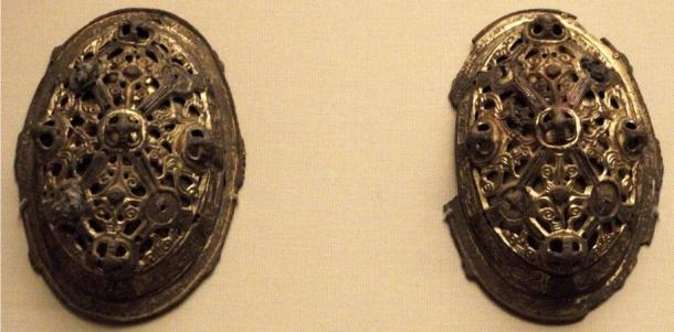 Pair of intricately crafted brooches, such as worn by most Viking women.