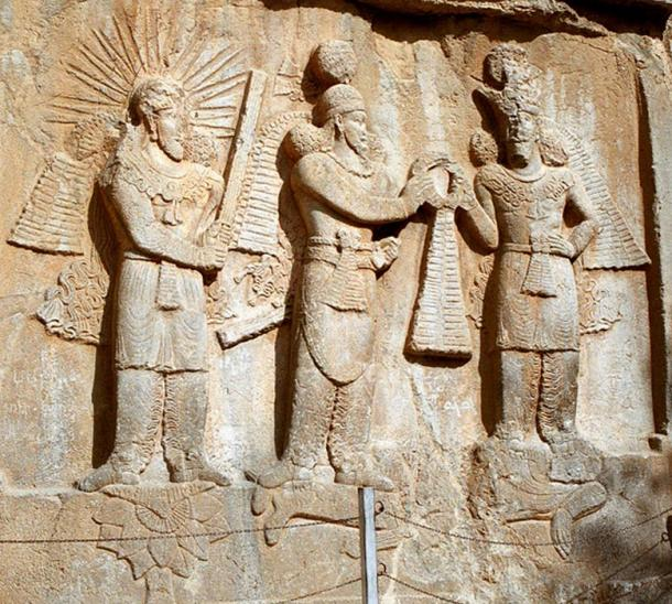 Mithra (left) in a 4th-century investiture sculpture at Taq-e Bostan in western Iran.