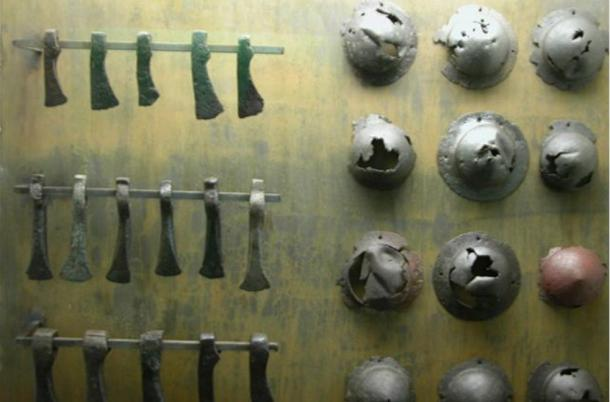 Objects, iron axes and shield bosses, discovered in Nydam Bog, Denmark.