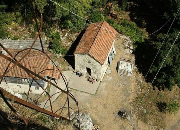 Looking down at the iron ladder and small monastery at the Katskhi Pillar.