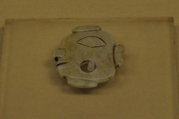 A jade artifact found at Shimao.