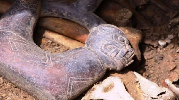 Close-up of the jaguar face of the black ceramic bottle discovered at the double tomb in Pacopampa, Peru