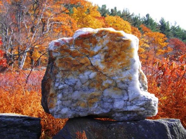 A large quartz block sits atop a stone lining