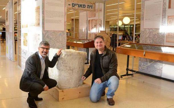 Dr. Gil Gambash, left, and Dr. Assaf Yasur-Landau with the large stone inscription.
