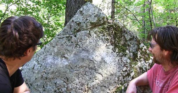 """""""A large triangular-shaped boulder features many esoteric symbols which also appear in James Churchward's books on the Lost Continet of Mu."""" Photograph © Dustin Naef 2016"""