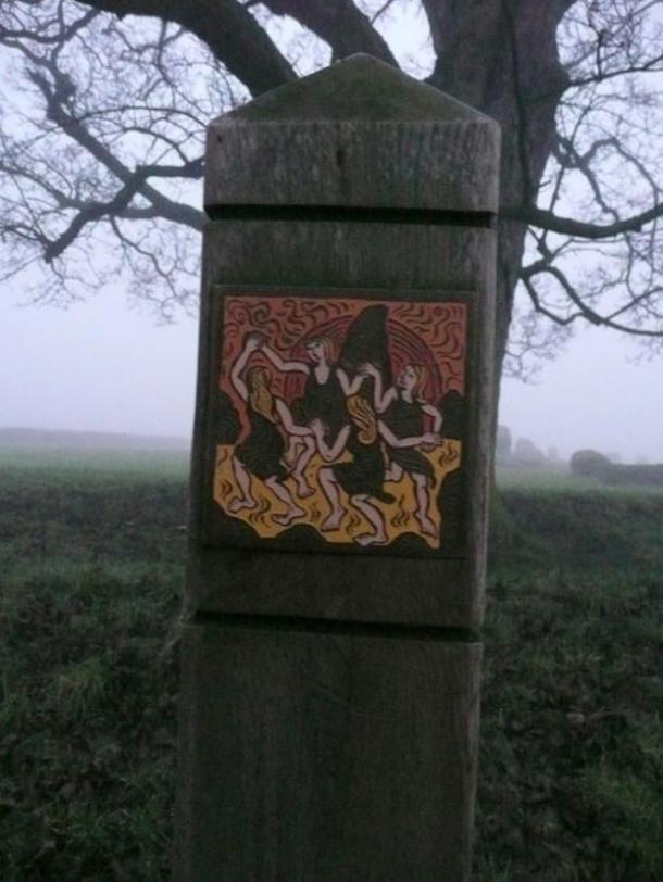 A plaque depicting the legend of Long Meg and her daughters; a coven of witches dancing on the moor before they were cast into stone.